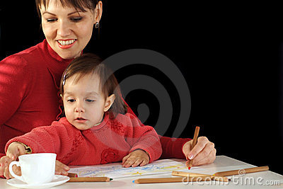 Mummy and daughter holding pencils