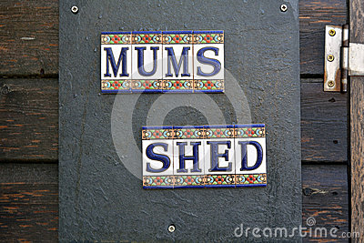 Mums Shed sign on door of garden shed