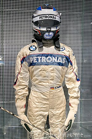 Free Munich, Germany - March 10, 2016: Formula One Suit Of BMW Race Car Driver Wearing Protective Leather And Helmet Stock Photos - 102552133