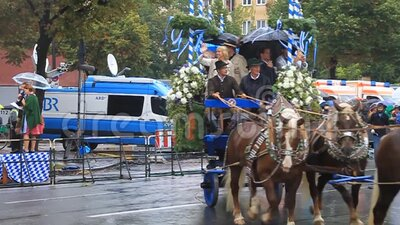 Participants of the annual opening parade of the Oktoberfest in Munich. stock video