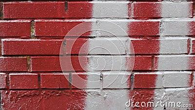 Mur de brique rouge éclaboussé d'un motif de peinture blanche texture de graffiti banque de vidéos