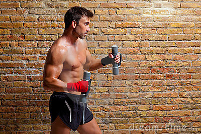 Muscle boxer man with fist bandage and weights