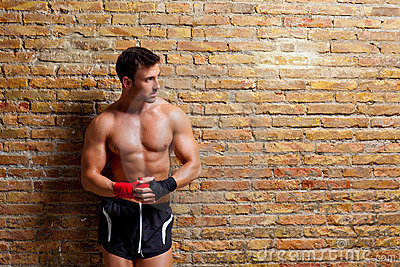 Muscle boxer shaped man with fist bandage