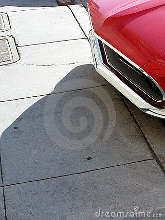 Muscle car nose sidewalk