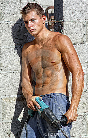 Muscle sexy naked dirty young man with drill