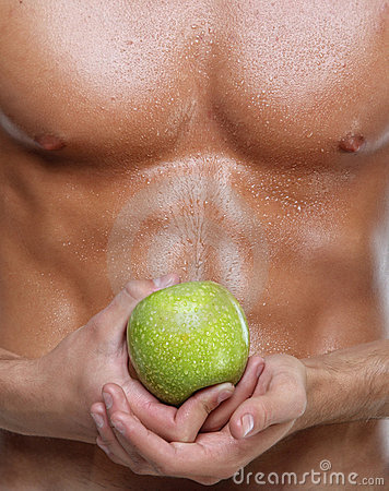Muscle sexy wet naked young man torso and apple