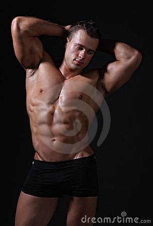 Muscle sexy wet nude young man posing