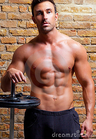 Free Muscle Shaped Body Man With Weights On Brick Wall Royalty Free Stock Photos - 22844668