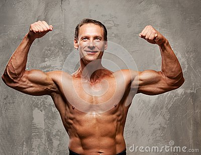 Muscle sportsman on a grey background