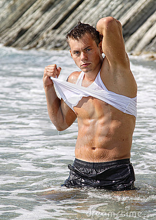 Muscle wet sexy man in sea water