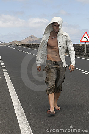 Free Muscled Man Walking On The Road Stock Image - 6132101