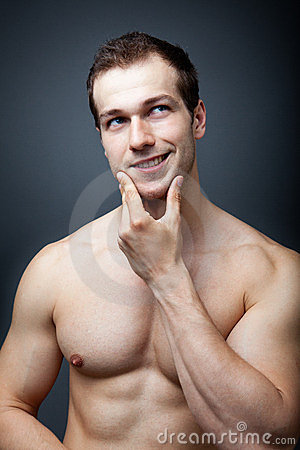 Muscles or brain? Muscular man thinking