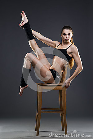 Free Muscular Attractive Fitness Woman On Gray Background In Studio Stock Image - 61363161
