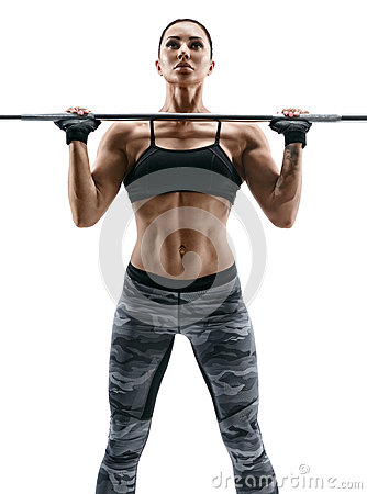Free Muscular Bodybuilder Woman Doing Exercises With Barbell Over White Background. Royalty Free Stock Photo - 90396445
