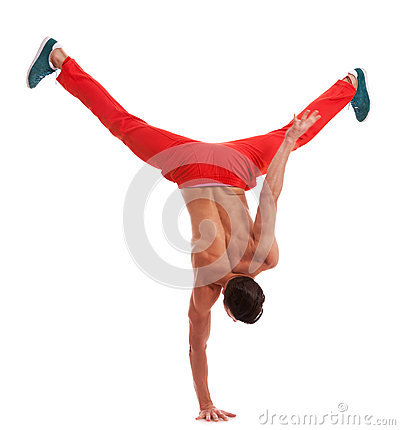 Muscular dancer standing on one hand