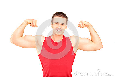 Muscular guy showing his muscles