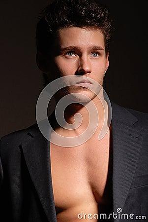 Muscular male in blazer