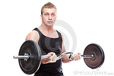 Muscular man with barbell in hands