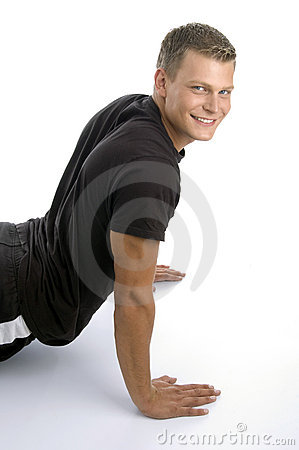 Muscular man doing push ups