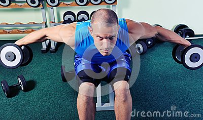 Muscular man exercise in a gym