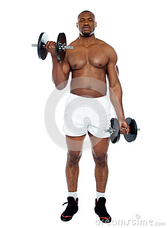 Muscular man exercising with dumbbells