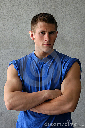 Free Muscular Man In A Blue T-shirt Royalty Free Stock Image - 6759176