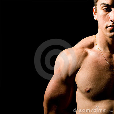 Muscular man isolated on black