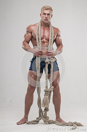 Muscular man with long rope