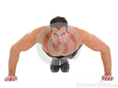 Muscular man making push up exercises