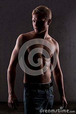 A muscular man posing