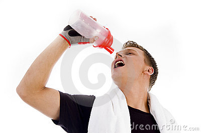 Muscular man posing with water bottle