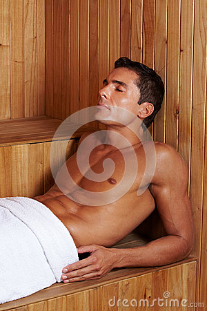 Muscular man in sauna