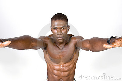 Muscular man stretching arms