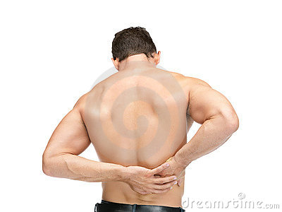 Muscular man suffering from back pain