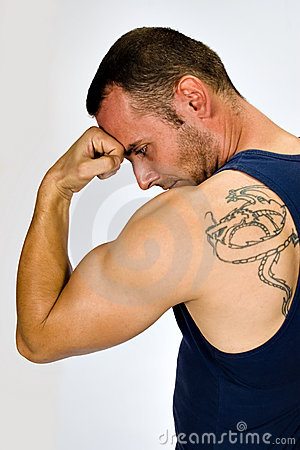 Muscular man with tattoo