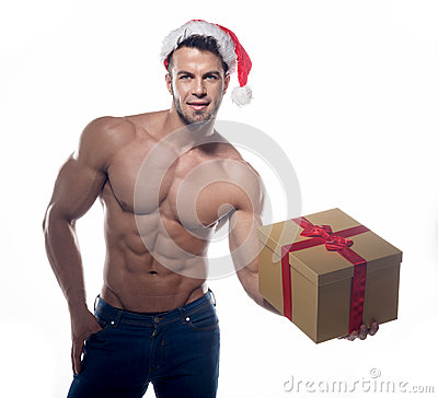 Free Muscular, Sexy Santa Claus With Gift Royalty Free Stock Photography - 41871217