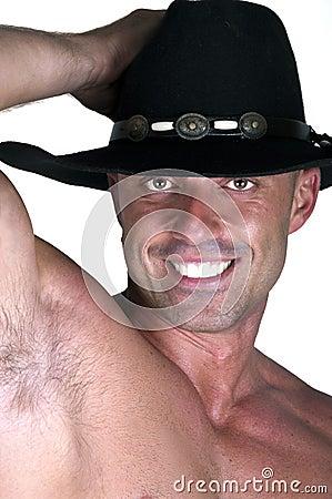 Muscular smiling cowboy