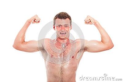 Muscular sports man showing biceps