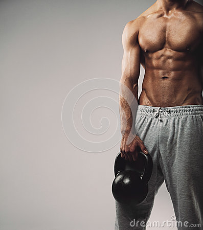 Free Muscular Young Guy With Kettle Bell Royalty Free Stock Photos - 42272788