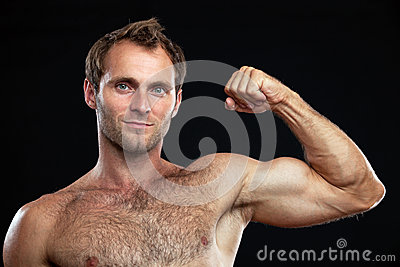 Muscular young man flexing his bicep