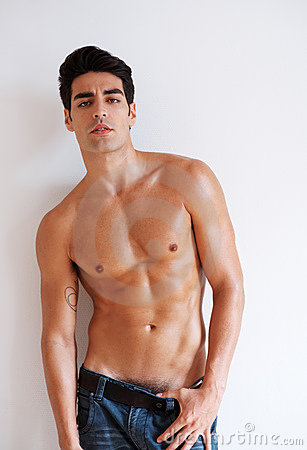 Muscular young man posing confidently