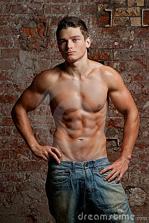 Free Muscular Young Naked Man Posing In Blue Jeans Stock Photo - 22720880