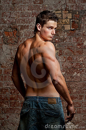 Muscular young naked sexy man in jeans