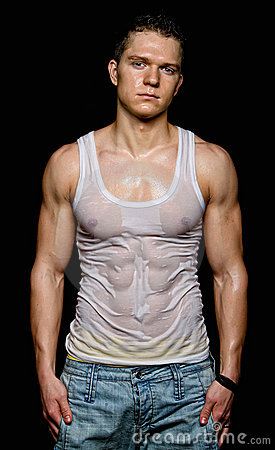 Muscular young sexy man in the white wet t-shirt