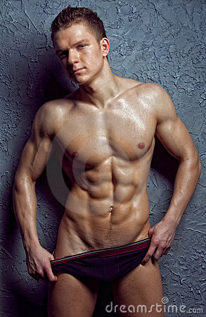 Muscular young sexy wet man in underwear