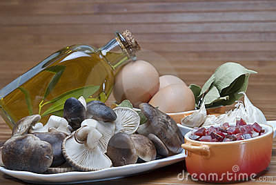 Mushrooms, eggs, ham and olive oil to cook.