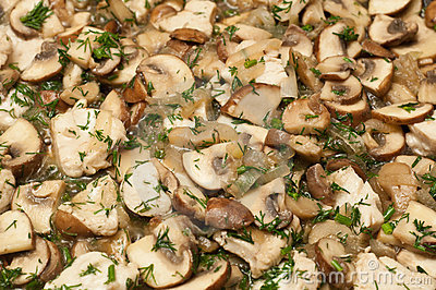 Mushrooms frying in a pan