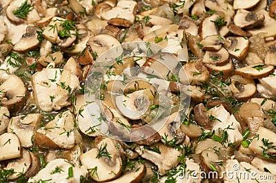 Mushrooms frying in a pan