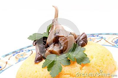 Mushrooms On Top Of Corn Mush
