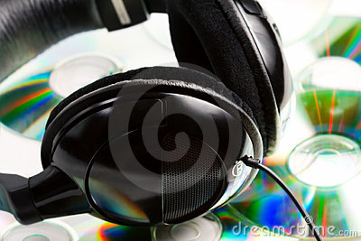 Music concept - headphones and audio cds